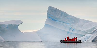 Zodiac craft near iceberg, Antarctica