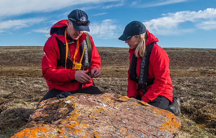 Viking Tour Director and Karine Hagen inspecting arctic flora