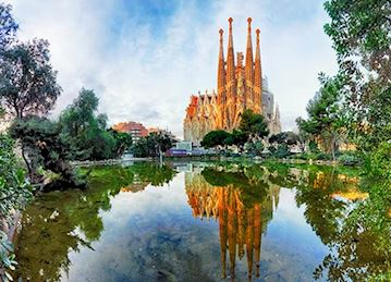 Sagrada Familia and lake at sunrise in Barcelona
