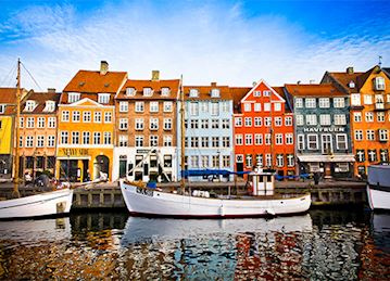 Colorful facades and boats along Nyhavn in Copenhagen, Denmark