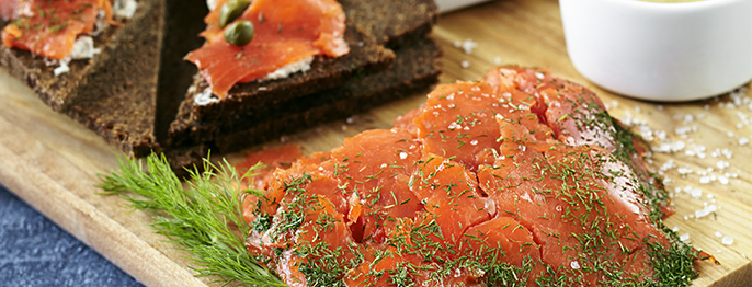 Lox on brown bread with finely chopped dill and a sprinkling of crystal sea salt.