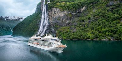Viking Ocean vessel sailing near fjord in Norway