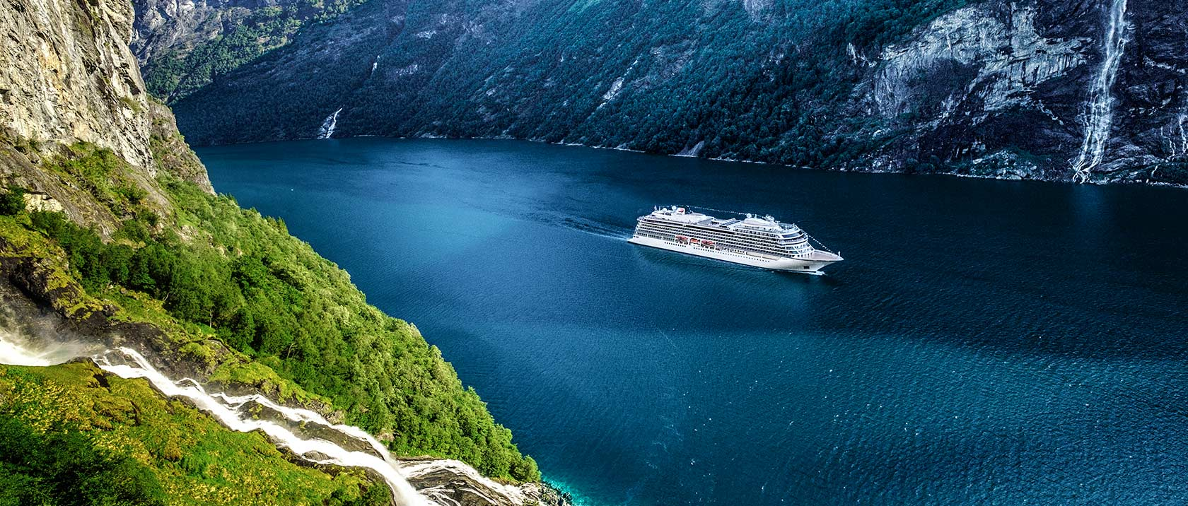 Viking ocean ship sailing through a Scandinavian fjord