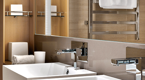 Closeup of a set of sparkling bathroom sinks in a Penthouse Jr. Suite.