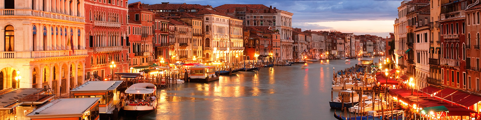 The Venice canals lit up at dusk