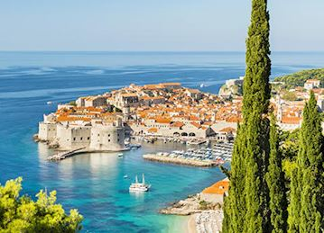 Old town Dubrovnik with red roofs and blue water