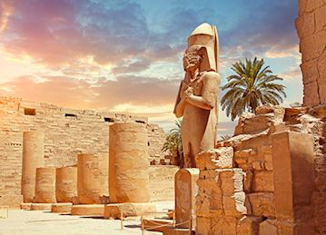 Pharaoh statue and ruins of Karnak Temple, Luxor