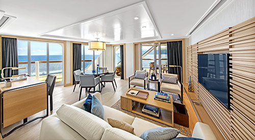View of the Living room area of the Explorer Suite stateroom