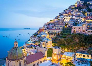 Colorful Coastal homes lit up at twilight in Positano
