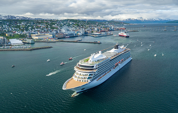 Aerial view of a Viking ocean ship sailing past Tromsø, Norway