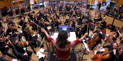 "Orchestra plays ""The Traveler"""