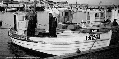 Historical photo of Danish fishermen on boat