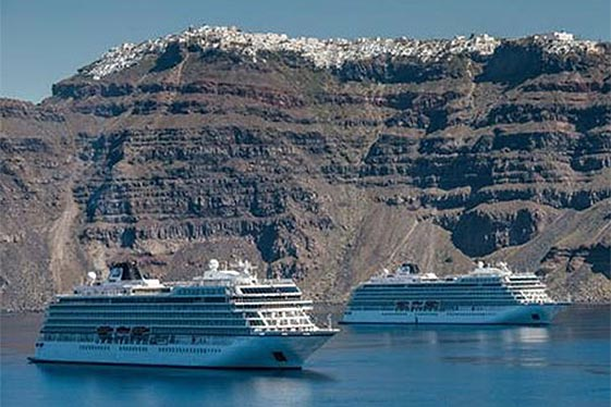 Viking Ocean vessels anchored near mountains